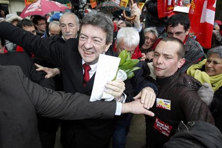 Jean-Luc Melenchon (L), leader of France's Parti de Gauche political party and the Front de Gauche political party's candidate for the 2012 French presidential election, arrives during a campaign visit to Pau April 15, 2012. REUTERS/Marc Zirnhel