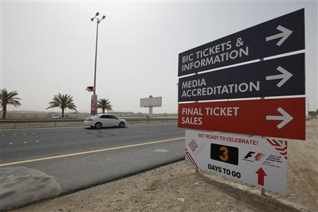 A car passes information signs on a highway leading to the Bahrain International Circuit at Sakhir, south of Manama, April 17, 2012. REUTERS/Hamad I Mohammed