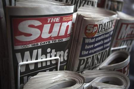 Copies of The Sun newspaper are displayed at a kiosk in London February 13, 2012. REUTERS/Finbarr O'Reilly
