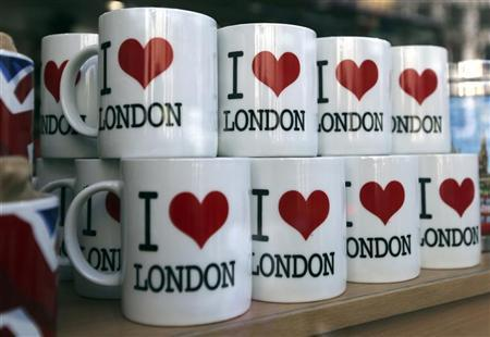 Mugs are seen for sale in a souvenir shop in London March 24. 2012. REUTERS/Chris Helgren