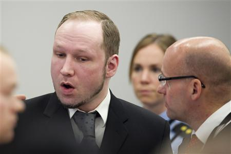 Norwegian anti-Muslim fanatic Anders Behring Breivik stands with his defence lawyer Geir Lippestad (R) during the morning break on the sixth day of his trial in Oslo April 23, 2012. REUTERS/Heiko Junge/NTB Scanpix