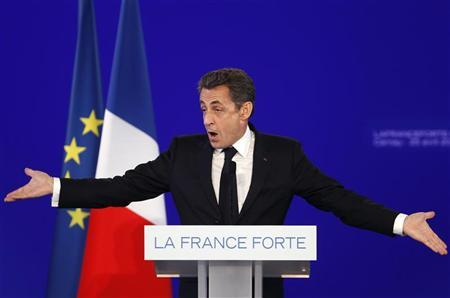 France's President and UMP party candidate for the 2012 French presidential elections Nicolas Sarkozy delivers a speech during a political campaign rally in Cernay near Mulhouse, April 25, 2012. REUTERS/Vincent Kessler