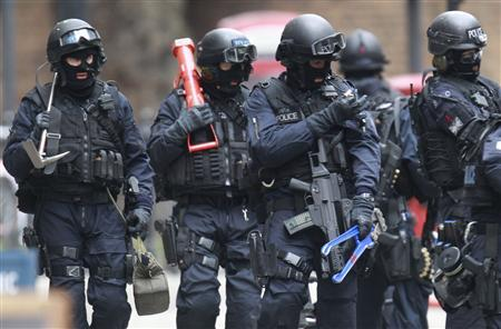 Armed police officers walk in Tottenham Court Road in central London April 27, 2012. REUTERS/Luke MacGregor