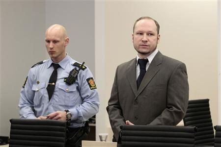 Norwegian anti-Muslim fanatic Anders Behring Breivik stands in a courtroom during his trial in Oslo April 26, 2012. REUTERS/Hakon Mosvold Larsen/NTB Scanpix/Pool