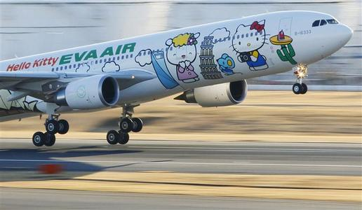 Eva Airways aircraft painted with Hello Kitty characters takes off at Narita international airport in Narita, east of Tokyo, in this photo taken by Kyodo December 26, 2011.   REUTERS/Kyodo