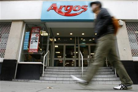 A pedestrian passes a branch of Argos in, central London October 19, 2008. Home Retail Group owns Homebase DIY chain and the 720-store catalogue-based retailer Argos. REUTERS/Andrew Winning