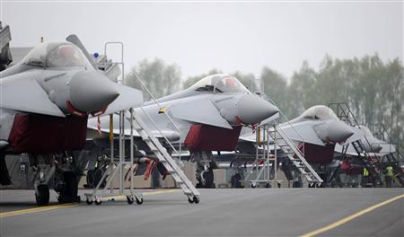 Royal Air Force Typhoon jets taking part in defence exercises in advance of the London 2012 Olympic Games are seen on the flight line after landing at RAF Northolt in west London May 2, 2012. REUTERS/Paul Hackett