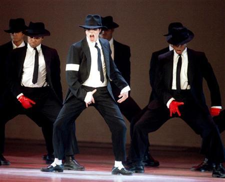 Pop star Michael Jackson (C) dances with a troupe at the MTV Video Music Awards at Radio City Music Hall in New York in this September 7, 1995 file photo. REUTERS/Mark Cardwell/Files