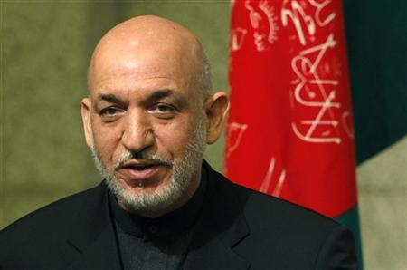 Afghan President Hamid Karzai leaves from the podium after delivering a speech at a seminar hosted by the Japan Institute of International Affairs in Tokyo June 18, 2010. REUTERS/Issei Kato