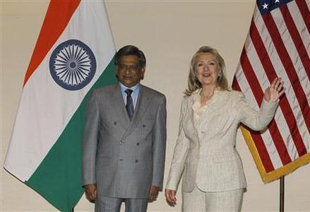 U.S. Secretary of State Hillary Clinton gestures as India's Foreign Minister Somanahalli Mallaiah Krishna (L) watches during a photo opportunity ahead of their meeting in New Delhi May 8, 2012. REUTERS/Adnan Abidi