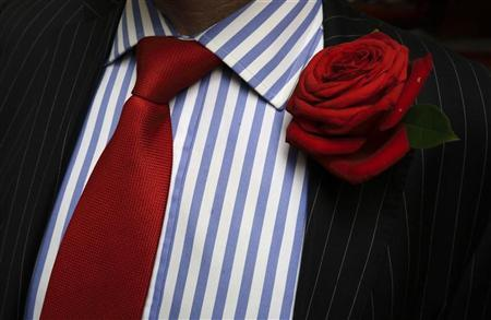 Steve Palmer, an insurance credit controller, displays his red rose and tie to celebrate St George's day in the City of London April 23, 2012. The Rose is the national flower of England. REUTERS/Kevin Coombs