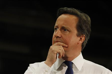 Britain's Prime Minister David Cameron listens as Deputy Prime Minister Nick Clegg answers a question from the public at CNH Tractors in Basildon, southeast England May 8, 2012. REUTERS/Suzanne Plunkett
