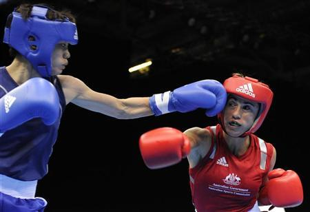 Women's flyweight boxers Lin Jinmei of China (L) and Bianca Elmir of Australia compete during the Olympic boxing venue test event at the Excel centre in east London November 25, 2011. REUTERS/Paul Hackett