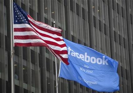 A flag announcing the IPO of Facebook flies next to the American flag outside the offices of J.P. Morgan in New York City, New York May 4, 2012. REUTERS/Lee Celano