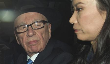 News Corporation Chief Executive and Chairman, Rupert Murdoch, leaves with his wife Wendi after giving evidence for the second day at the Leveson Inquiry at the High Court in London April 26, 2012. REUTERS/Olivia Harris