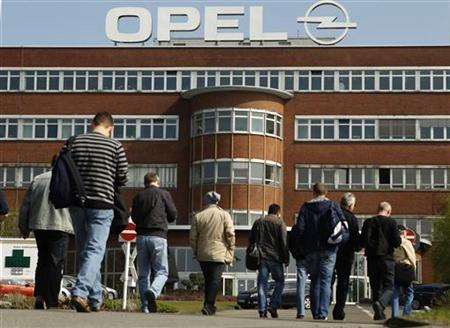 Workers arrive for their change of shift at the Opel plant of Bochum in March 28, 2012. REUTERS/Ina Fassbender