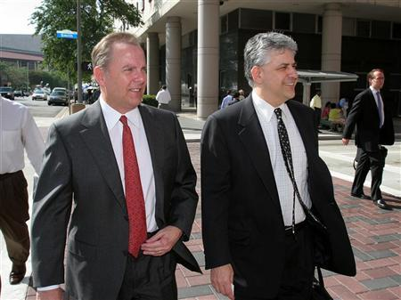Former Enron CEO Jeffrey Skilling (L) and attorney Daniel Petrocelli leave Federal court in Houston for the day April 18, 2006. REUTERS/Richard Carson