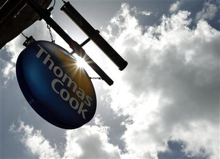 A sign hangs in front of a branch of travel agent Thomas Cook in London May 9, 2011. REUTERS/Luke MacGregor
