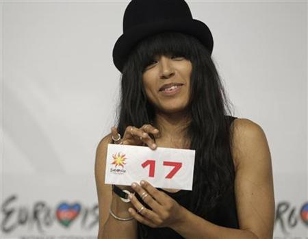 Loreen of Sweden shows her number for the grand final during a news conference after the second semi-final of the Eurovision Song Contest in Baku May 25, 2012. REUTERS/David Mdzinarishvili