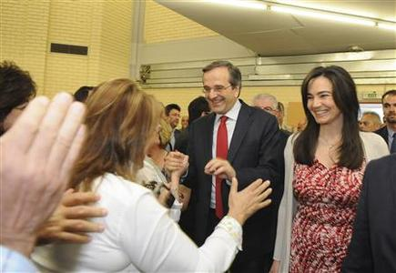 Conservative New Democracy party leader Antonis Samaras (2nd R) greets supporters during a pre-election rally in Athens May 26, 2012. REUTERS/Willy Antoniou/Handout