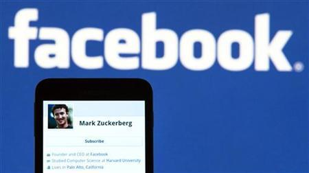 The Facebook profile of founder Mark Zuckerberg on a mobile phone is seen in this photo illustration taken in Lavigny May 16, 2012. REUTERS/Valentin Flauraud