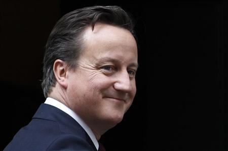 Prime Minister David Cameron gestures outside 10 Downing Street in London May 10, 2012. REUTERS/Suzanne Plunkett