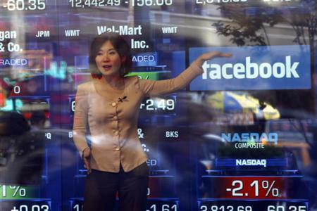 A television reporter talks about the Facebook IPO at the NASDAQ Marketsite in New York May 17, 2012. REUTERS/Keith Bedford
