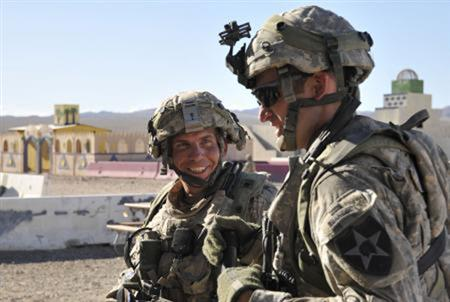 Staff Sgt. Robert Bales, (L) 1st platoon sergeant, Blackhorse Company, 2nd Battalion, 3rd Infantry Regiment, 3rd Stryker Brigade Combat Team, 2nd Infantry Division, is seen during an exercise at the National Training Center in Fort Irwin, California, in this August 23, 2011 DVIDS handout photo. REUTERS/Department of Defense/Spc.