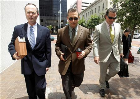 Actor Stephen Baldwin (C) arrives with his legal team at the New Orleans Federal Court House in New Orleans June 4, 2012. Balwin and fellow actor Kevin Costner opened a real-life legal drama on Monday as jury selection began in a trial over Baldwin's claims that Costner cheated him out of his share of a multi-million dollar deal to sell oil extractors to British Petroleum in 2010. REUTERS/Sean Gardner