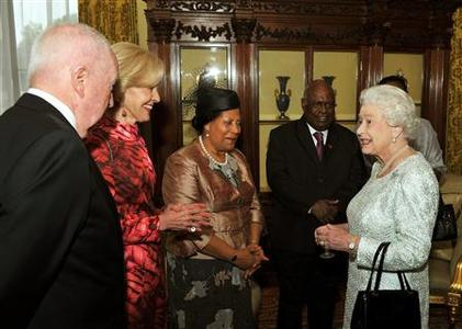 Queen Elizabeth (R) talks with Australia's Governor General Quentin Bryce (2nd L) and Antigua and Barbuda Governor General Louise Lake-Tack (3rd L)during a reception for Commonwealth Governors General at Buckingham Palace in central London June 5, 2012. REUTERS/John Stillwell/POOL