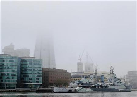 Fog shrouds the top of the Shard building under construction in London April 13, 2012. REUTERS/Luke MacGregor