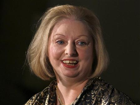 Author Hilary Mantel laughs during a photocall after winning the 2009 Man Booker Prize for Fiction with her book ''Wolf Hall'' the the Guildhall in London October 6, 2009. REUTERS/Luke MacGregor