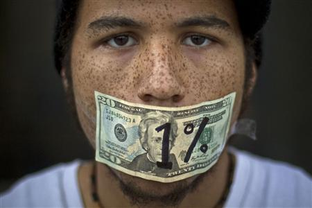Roshan Bliss, who says he has a debt of $50,000 in school loans, attends an Occupy Denver demonstration in Denver, Colorado to celebrate the two-month anniversary of Occupy Wall Street in this November 17, 2011 file photograph. REUTERS/Nathan W. Armes/Files