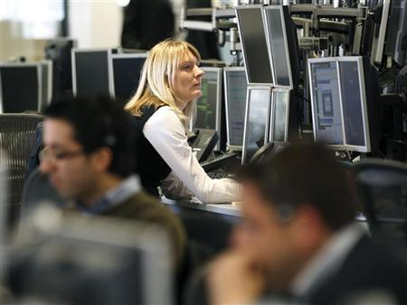 Dealers monitor their screens on the trading floor of IG Index in London May 6, 2010. REUTERS/Kevin Coombs