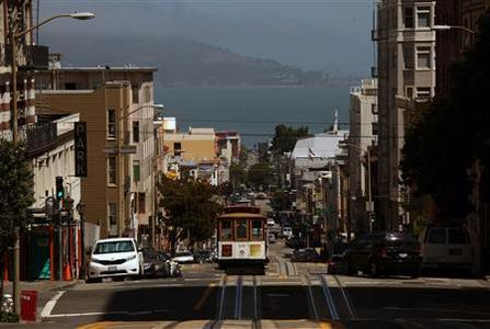 A cable car climbs Powell Street as it approaches California Street in San Francisco, California May 27, 2012. REUTERS/Robert Galbraith