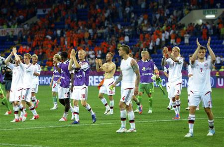 Denmark's players celebrate winning their Group B Euro 2012 match against Netherlands in Kharkiv June 9, 2012. REUTERS/Felix Ordonez