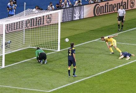 Ukraine's Andriy Shevchenko (R) scores against Sweden during their Group D Euro 2012 match at the Olympic stadium in Kiev, June 11, 2012. REUTERS/Michael Dalder