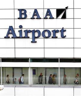 People walk through a terminal in the BAA operated Glasgow airport in Scotland March 30, 2011. REUTERS/David Moir
