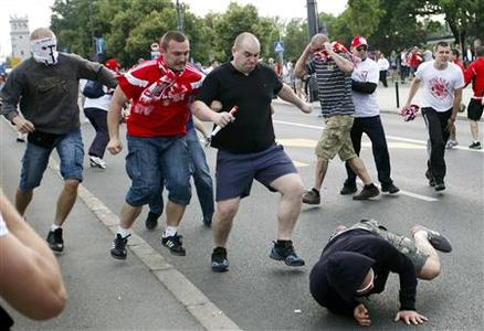 Polish and Russian fans clash outside the National Stadium in Warsaw, June 12, 2012. REUTERS/Jerzy Dudek