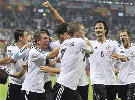 Germany's Mario Gomez (C) celebrates his goal against Portugal with teammates during their Group B Euro 2012 soccer match in Lviv, June 9, 2012. REUTERS/Thomas Bohlen