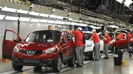 A worker is seen completing final checks on the production line at Nissan car plant in Sunderland, northern England, June 24, 2010. REUTERS/Nigel Roddis