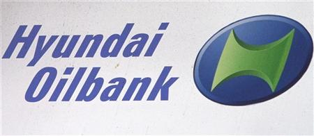A Hyundai Oilbank logo is seen at a gas station in Seoul March 29, 2012. REUTERS/Kim Hong-Ji
