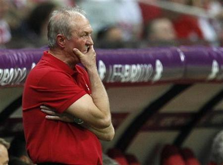 Poland's coach Franciszek Smuda watches their Euro 2012 Group A match against Greece at the National Stadium in Warsaw, June 8, 2012. REUTERS/Peter Andrews