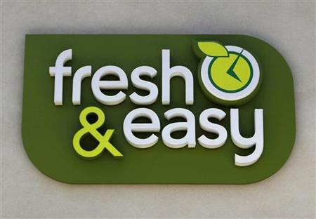 The logo on top of the Tesco's Fresh & Easy Neighborhood Market food store in Compton, California is seen May 13, 2009. REUTERS/Danny Moloshok (UNITED STATES BUSINESS FOOD)