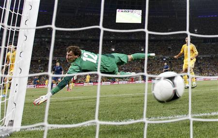Ukraine's goalkeeper Andriy Pyatov dives as France's Jeremy Menez (not pictured) scores during their Group D Euro 2012 soccer match at the Donbass Arena in Donetsk, June 15, 2012. REUTERS/Michael Buholzer