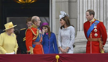 Britain's Queen Elizabeth looks on as her husband Prince Philip, The Duke of Edinburgh, speaks with Prince William and Catherine, Duchess of Cambridge with Prince Harry and Princess Beatrice on the balcony of Buckingham Palace following the Trooping the Colour ceremony in central London June 16, 2012. REUTERS/Toby Melville