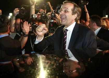 Leader of conservative New Democracy party Antonis Samaras is cheered by supporters after his statement on the election results in Athens June 17, 2012. REUTERS/John Kolesidis