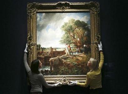 Gallery assistants pose with John Constable's The Lock which is on display at Christies in central London, June 12, 2012. REUTERS/Olivia Harris