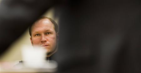 Mass murderer Anders Behring Breivik attends his trial in court in Oslo June 18, 2012. REUTERS/Vegard Groett/NTB Scanpix/Pool
