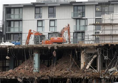 Construction diggers are seen at a site being demolished to make room for new apartment buildings in central London November 21, 2011. REUTERS/Chris Helgren